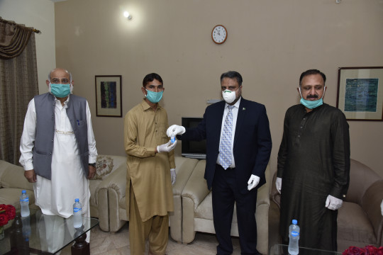 Worthy Vice Chancellor visits hostel and distributed Hand Sanitizers among Staff